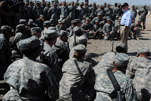 """Secretary of Defense Robert M. Gates speaks with Soldiers from United States Division-Center during a visit to Camp Liberty, Iraq, April 7, 2011. During the visit, Gates spoke with Soldiers from the division about the U.S. drawdown in Iraq, the repeal of the """"Don't Ask, Don't Tell"""" policy, and other changes throughout the Army."""