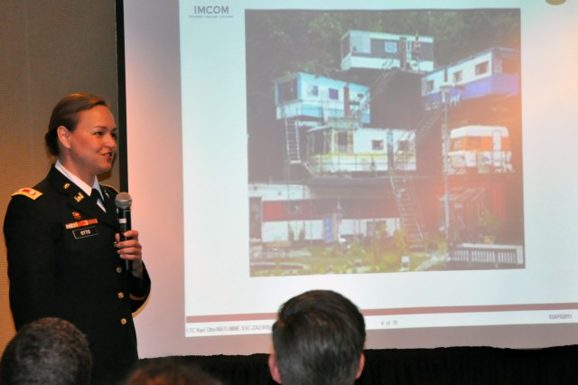 Lt. Col. Kari K. Otto, garrison commander, U.S. Army Garrison-Natick, speaks April 5 to the 2011 Army Master Planning Symposium in Boston. Otto gave her perspective on installation planning.