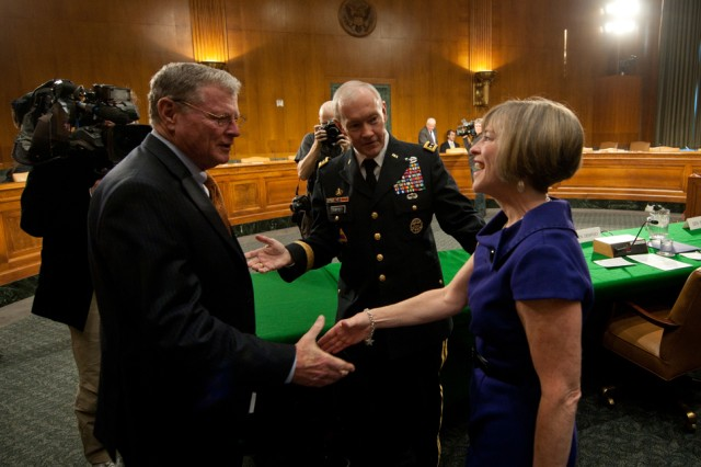 Gen. Martin Dempsey introduces his wife, Deanie, to Sen. James Inhofe before a Senate Armed Services Committee hearing on Capitol Hill in Washington D.C., Mar. 3, 2011.  Dempsey has been nominated by the President of the United States to serve as the 37th Chief of staff of the Army.