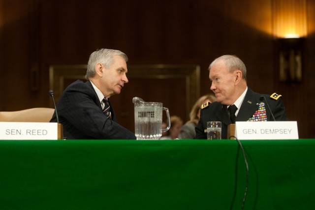 Sen. Jack Reed shakes hands with Gen. Martin Dempsey after introducing him at a Senate Armed Services Committee hearing on Capitol Hill in Washington D.C., Mar. 3, 2011.  Dempsey has been nominated by the President of the United States to serve as the 37th Chief of staff of the Army.