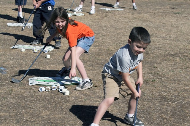 FORT CARSON, Colo. -- Clubs for Kids Day Saturday at Cheyenne Shadows Golf Course kicks off Month of the Military Child activities at Fort Carson. Children were provided golf clubs to practice their swing while volunteers gave them pointers. The golfers were then allowed to take the clubs home with them after the event. Directorate of Family and Morale, Welfare and Recreation officials offer many activities for children throughout April.