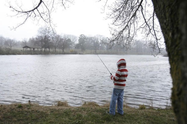 Will Loveless of Odenton waits patiently for a bite on the banks of Burba Lake. The 12-year-old competed in his age group for plaques and prizes during the four-hour Fishing Rodeo sponsored Saturday morning by the Meade Rod and Gun Club and Outdoor Recreation.