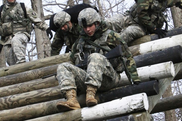 First Regiment team members brave a cold afternoon at Camp Buckner as they negotiate their way through the obstacle course during Sandhurst training. Eight company teams from each regiment have been training for months to compete in the annual Sandhurst Competition. The competition is designed to enhance small unit leadership qualities, develop teamwork and promote military excellence. It's not only physically and mentally strenuous, but diverse. Teams from Great Britain, Canada, Australia, Spain, Chile, Taiwan and Afghanistan comprise some of the international component, but the 32 West Point teams will also be challenged by the U.S. Air Force Academy and the U.S. Naval Academy. Rounding out the roster are ROTC and U.S. Military Academy Preparatory School teams.