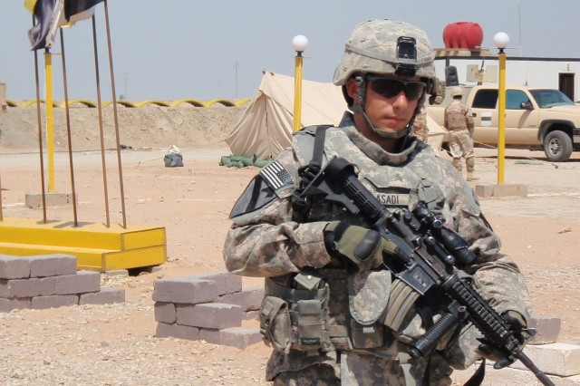 Sgt. Anthony Asadi, of Task Force 2nd Battalion, 82nd Field Artillery Regiment, 3rd Advise and Assist Brigade, 1st Cavalry Division, provides security for U.S. and Iraqi commanders at the Tadreeb al-Shamil training site, Iraq, March 30.