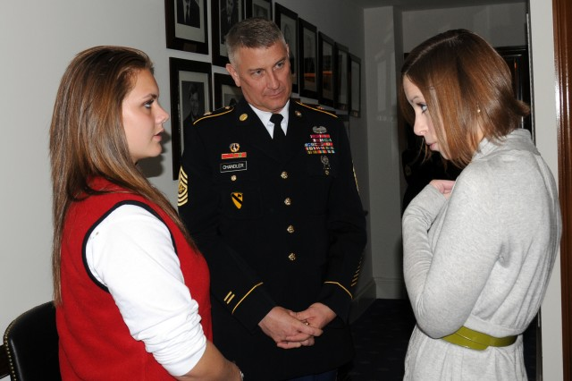 Army Teen Panel member Courtney Rinnert from California is joined by Sgt. Maj. of the Army Raymond Chandler, also of California, as they talk with Legislative Assistant Ariana E. Reks of Sen. Barbara Boxer's office, before Boxer arrives from a