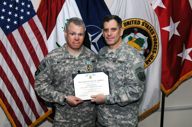 BAGHDAD - U.S. Army Lt. Col. Kevin J. Butler receives a Joint Service Commendation Medal from United States Forces-Iraq's Deputy Commanding General for Advising and Training, U.S. Army Lt. Gen. Michael Ferriter, here April 7. Butler spent three months in the Kurdistan Region advising the Ministry of Peshmerga's Directorate of Training on its Basic Combat Training Program and Basic Combat Training Instructor Course.