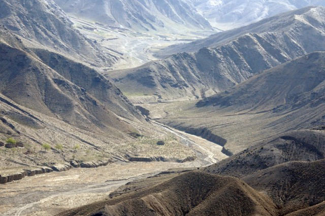 SPIN BOLDAK, Afghanistan - An aerial view of a valley along the Afghanistan-Pakistan border, April 4, 2011. Afghan Border Police regularly conduct patrols in areas like this, to prevent smugglers from sneaking drugs and explosives into the country. (Army Photo by Spc. Jonathan W. Thomas, 16th Mobile Public Affairs Detachment)