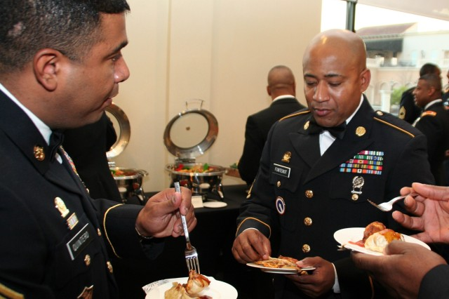 Master Sgt. Eliicer Quintero, 410th Contracting Support Brigade (left) and SGM Vincent A. Fontenot, 412th CSB, enjoy appetizers prior to the start of the formal festivities.