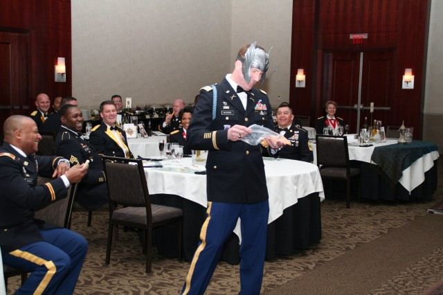 With Nordic type head dressing, Lt. Col. Dennis M. McGowan, 905th Contingency Contracting Battalion, provides a bit of humor during the Dining In.