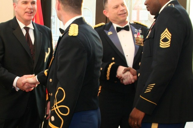 Jeff Parsons, Army Contracting Command executive director, and Brig. Gen. Joe Bass, Expeditionary Contracting Command, commanding general, welcome ECC soldiers and guests to the command\'s first Dining In. Bass served as the function's president of the mess.