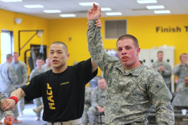 Spc. Mitchel Dolan, right, with Headquarters and Headquarters Detachment, 378th Military Intelligence Battalion, is declared the overall winner in the combatives event of the Military Intelligence Readiness Command's 2011 Best Warrior competition, held at Fort Dix, N.J.  Dolan competed against Soldiers from both the MIRC and the 99th Regional Support Command.  Spc. Dolan was named Best Warrior Soldier.  (U.S. Army Reserve Photo by Maj. Annmarie Daneker/Released)