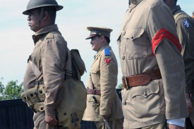 Participants wear U.S. and Filipino-style World War II uniforms