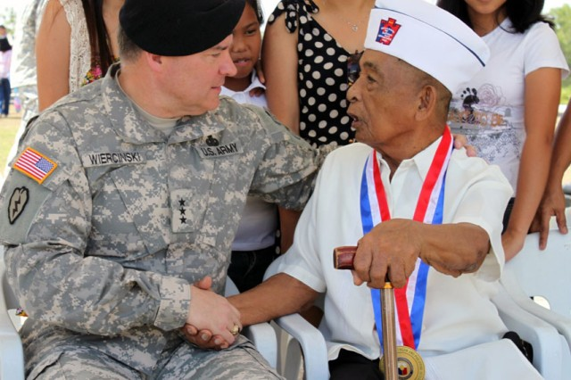 Lt. Gen. Francis J. Wiercinski, commander of U.S. Army Pacific, speaks with Rosario S. Baclig, a survivor of the Bataan Death March. Wiercinski was among the distinguished visitors to place a wreath at the base of Capas National Shrine, April 10, in remembrance of the Death March.