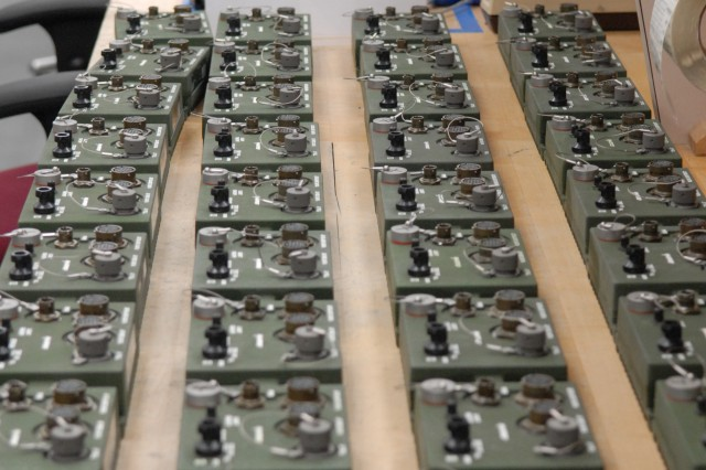 Secure Communications Branch employees make hundreds of KGV-72 mock ups for use as training aids.