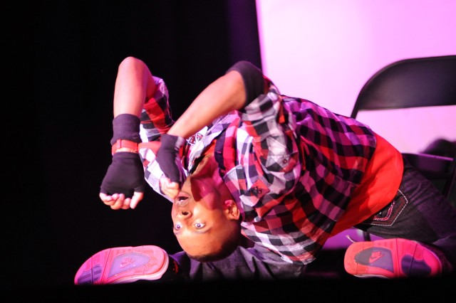 """Hip-hop dancer Spc. Joseph Coine of Fort Campbell, Ky., exhibits great flexiblity while dancing to Mishon's """"Distant Love"""" during live auditions for the 2011 U.S. Army Soldier Show at Wallace Theater on Fort Belvoir, Va. (U.S. Army photo)"""