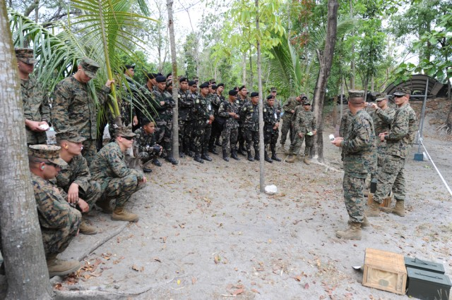 "U.S. Marines assigned to Camp Foster, Okinawa, Japan and members of the Philippine Air Force gather for a safety brief before training on the use of the M-203 grenade launcher and the Mossberg 500 shotgun while participating in Exercise Balikatan 2011 on April 7 at Clark Field, Philippines. Balikatan means ""shoulder to shoulder"" in Tagalog and is an annual Republic of the Philippines and United States bilateral military humanitarian assistance and training exercise that is taking place in the Philippines April 5-15. The training helps maintain readiness and sustain the long-term security assistance relationship shared between the two countries."