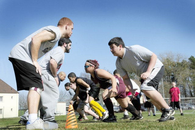 Vilseck High School students (right) face-off with members of the Frankfurt Universe American football team out of Frankfurt, Germany, during a football clinic held at the high school. During the two-day clinic, players from the Frankfurt Universe ran scrimmage with the young football players, teaching them various techniques and improving their knowledge of the game.