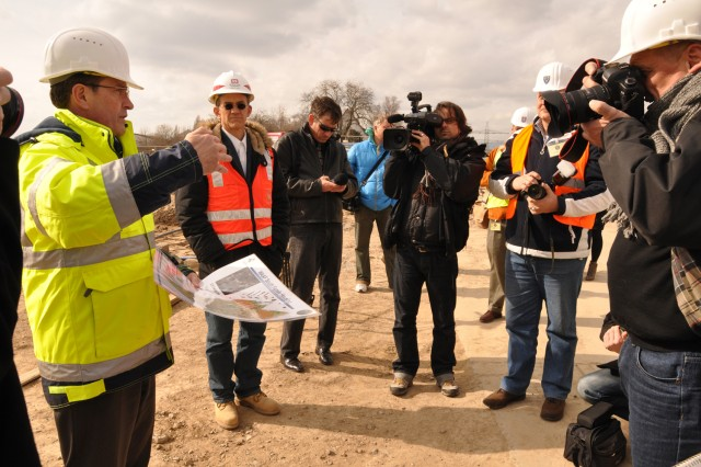 Roger Gerber, USAG Wiesbaden's Transformation Stationing Management Office director, briefs members of the local host nation media on ongoing transformation efforts within the garrison.