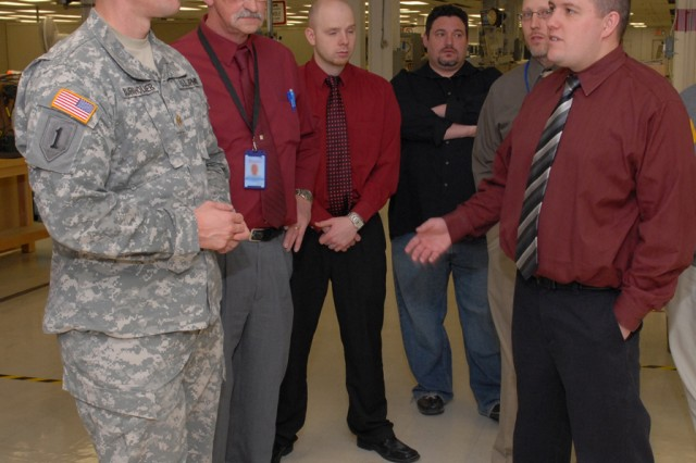 Kris Martin (right), logistics management specialist, works on multi-million dollar projects that support the AN/TRC-190.