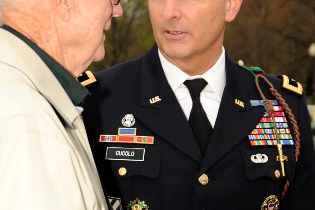 Major General Tony Cucolo talks with a Savannah Georgia Honor Flight Veteran visiting the WWII Memorial in Washington, D.C., April 9, 2011.