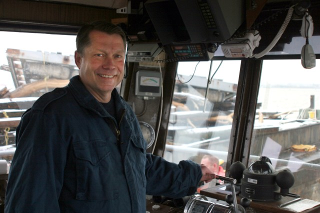 Bill Lyness, boat captain with the U.S. Army Corps of Engineers, gets ready for a day commanding the Gelberman, a drift collection vessel in the New York Harbor.