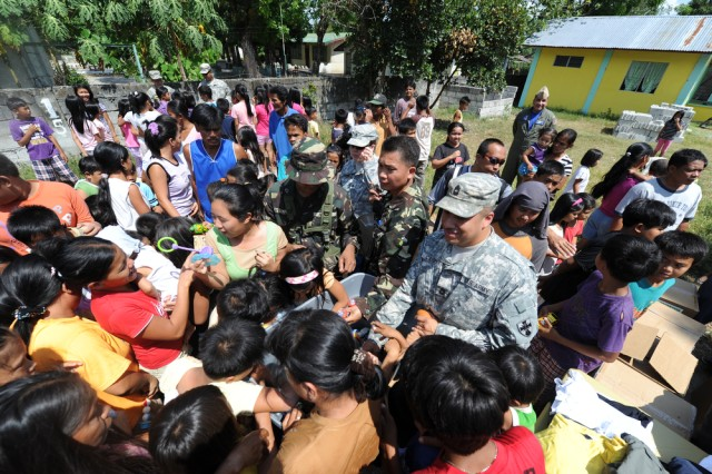 Philippine and US service members hand out toys