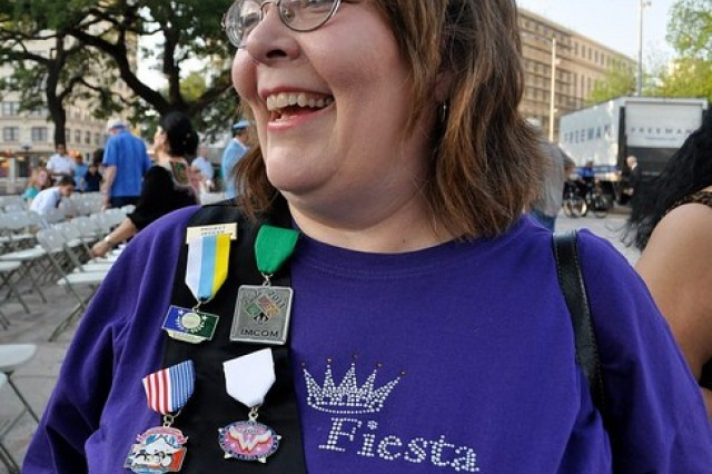 Maggie Brewster, director of Installation Management community relations, displays her sash with the IMCOM Fiesta 2011 medal