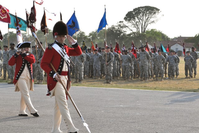 The Fife and Drum Corps demonstrates marching music as Joint Base San Antonio Soldiers look on