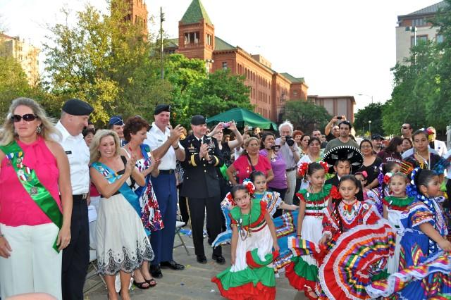 Lt. Gen. Rick Lynch, his wife Mrs. Sarah Lynch, Command Sgt. Maj. Neil Ciotola, his wife Mrs. Beth Ciotola and Maj. Gen. Perry Wiggins watch as flamenco dancers kick up their heels