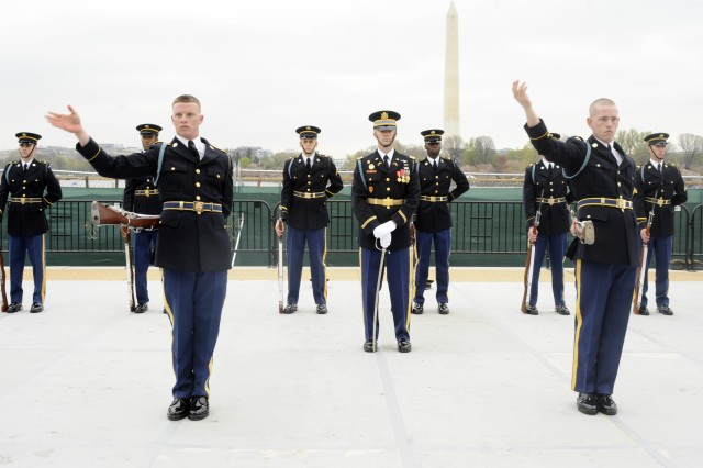 Spc. Shane Humphrey (left) and Spc. Wesley Williams (right), U.S. Army Drill Team, 3d U.S. Infantry Regiment (The Old Guard) perform a unique exhibition of synchronized rifle drill during the 4th Annual Joint Service Drill Exhibition at the Jefferson Memorial, Washington, D.C. on April 9.