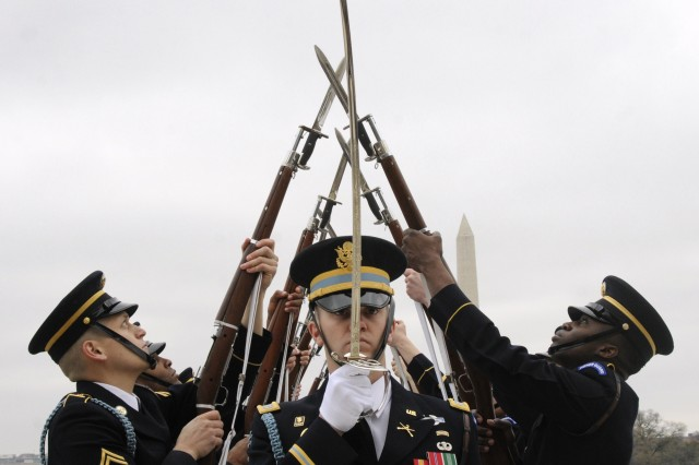 Capt. Christopher Miorin, Commander, U.S. Army Drill Team, 3d U.S. Infantry Regiment (The Old Guard), salutes the audience during the 4th Annual Joint Service Drill Exhibition at the Jefferson Memorial, Washington, D.C. on April 9. The U.S. Army Drill Team is one of the finest examples of what hard training, constant practice, and teamwork produces in today's Army.