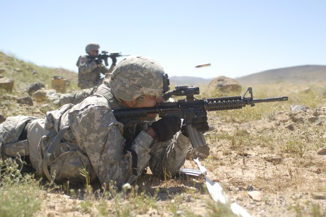 FORT IRWIN, Calif-A team of Soldiers fire at targets during 2nd Squadron's Spur Ride, April 4. (Photo by Sgt. Giancarlo Casem, 11th ACR Public Affairs)