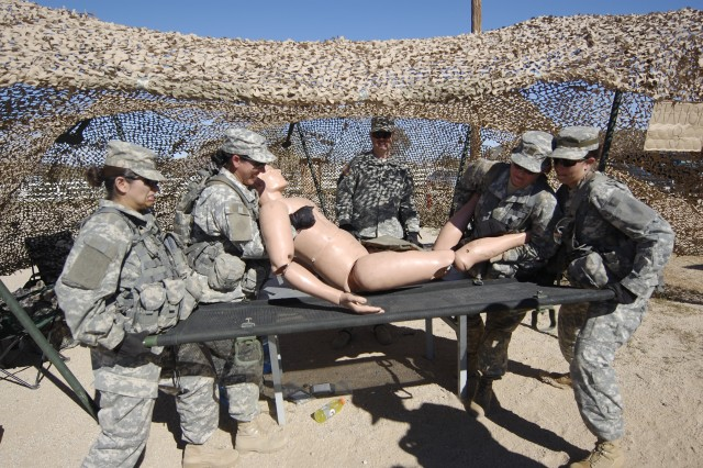 FORT IRWIN, Calif.-Soldiers prepare to transport a training mannequin during the Regimental Support Squadron's Spur Ride, April 4. (Photo by Sgt. Giancarlo Casem, 11th ACR Public Affairs)