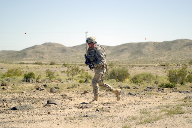 FORT IRWIN, Calif-A Soldier from 2nd Squadron, 11th Armored Cavalry Regiment, performs a 3-5 second rush during the Eaglehorse Squadron Spur Ride, April 4. (Photo by Sgt. Giancarlo Casem, 11th ACR Public Affairs)
