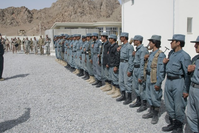 TAKHTEH POL, Afghanistan - Gul Mohammad, Takhteh Pol District Chief of Police, orders Afghan National Police to the position of attention prior to a renovated ANP station's ribbon cutting ceremony in Takhteh Pol, Afghanistan, April 11, 2011. The newly renovated police station houses about 45 ANP responsible for providing security and stability to the 115 villages in the surrounding area. (photo by Senior Airman Jessica Lockoski)