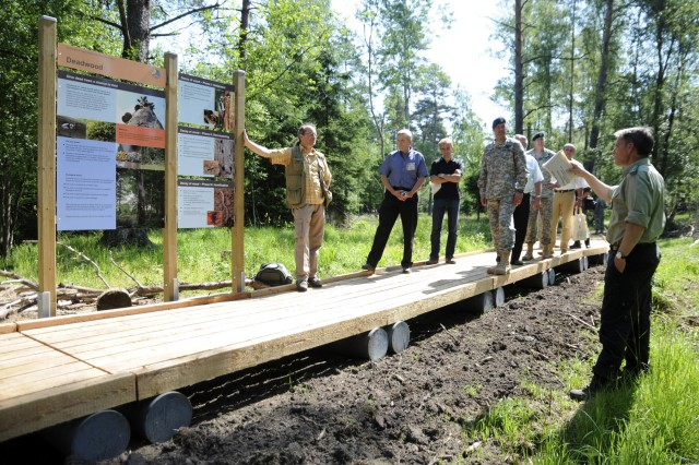 The first walk of the newly constructed nature trail included the JMTC Commander BG Salazar, Garrison Commander COL Sorensen, Forest Director Maushake and Grafenwoehr Mayor Waechter.  Conducted in June 2010, this event also included both U.S. and German guests.  The trail provides environmental facts and nature information and is located near the future outdoor recreation center.