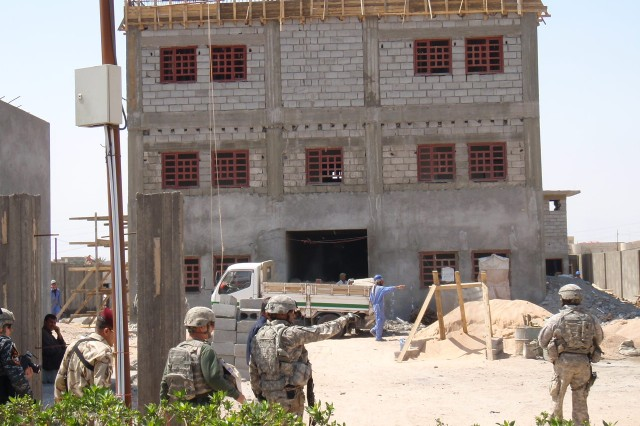 Members of the Stability Transition Team, 1st Battalion, 12th Cavalry Regiment, 3rd Advise and Assist Brigade, 1st Cavalry Division, visit the construction site for the al-Hussein Iraqi Police Station, one of the newest in the area.