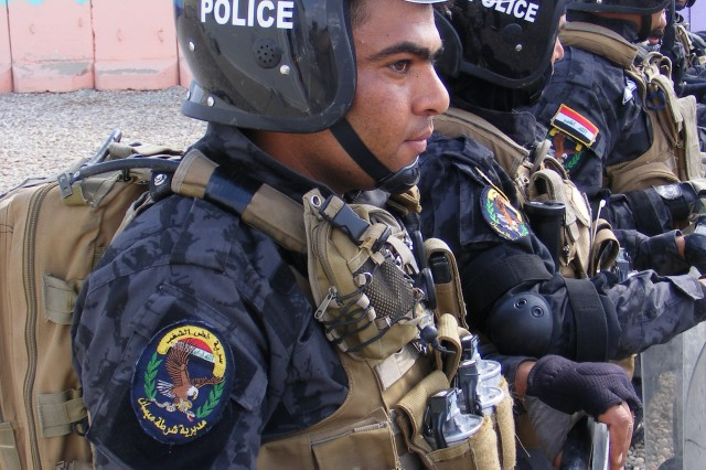 CONTINGENCY OPERATING BASE ADDER, Iraq -Policemen from the Iraqi Police Emergency Response Unit in Maysan Province, Iraq, stand in formation during riot-control training organized by 3rd Battalion, 8th Cavalry Regiment, 3rd Advise and Assist Brigade, 1st Cavalry Division.