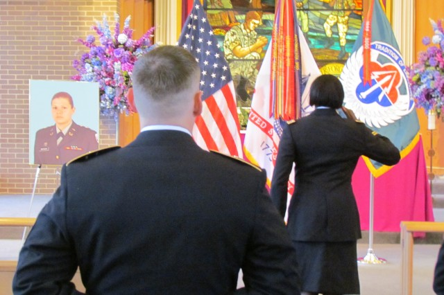 Thursday's memorial service guests honor Capt. Laura Matejik Eberts, who died March 21.