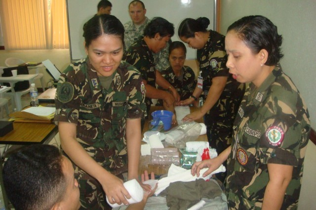 Armed Forces of the Philippines Nurse Corps members conduct a splinting practical exercise during a medical exchange between the U.S. and Philippine armies.  The five-day exchange was held during Balikatan 2011.
