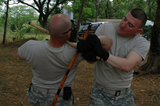 1st Lt. Casey R. Kiernan (right), defends against Pfc. Harold R. Henson's attack during hand-to-hand combat training at Fort Magsaysay, Philippines, April 7. Both soldiers, part of Apache Troop, 4th Squadron, 7th Cavalry Regiment, 2nd Infantry Division, are part of Exercise Balikatan 2011, an annual joint exercise between the armed forces of the United States and the Republic of the Philippines.