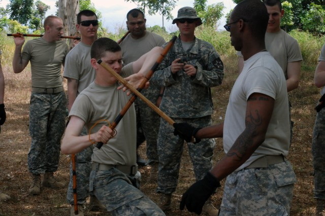 Pfc. Eric J. Hulbig (left) reacts to an attack from Sgt. Avery B. Mack as part of  hand-to-hand combat training at Fort Magsaysay, Philippines, April 7. Both soldiers, part of Apache Troop, 4th Squadron, 7th Cavalry Regiment, 2nd Infantry Division, are part of Exercise Balikatan 2011, an annual joint exercise between the armed forces of the U.S. and the Republic of the Philippines.