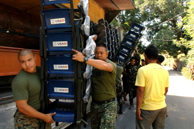 Troops deliver chairs, desks to multiple school sites