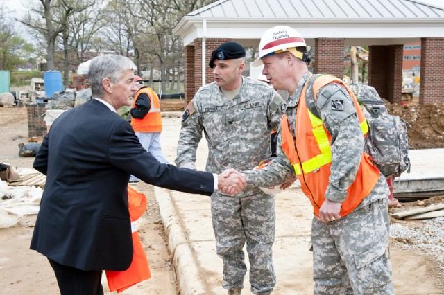 FORT BELVOIR, Va. -- Secretary of the Army John McHugh (left) greets Col. Dave Anderson, U.S. Army Corps of Engineers Baltimore District commander, at a wounded warrior complex project site here, April 13, 2011. Looking on is Col. John Strycula, Fort Belvoir garrison commander. The secretary visited the site of the wounded warrior complex, as well as the new $1 billion Fort Belvoir Community Hospital, and DeWitt Army Community Hospital for a firsthand look at facilities which will provide care for wounded warriors here. (U.S. Army photo by Marc Barnes)
