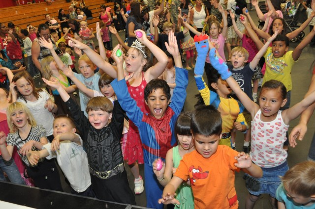 "Children dance to ""YMCA"" during Baby Loves Disco April 5 at Fort Irwin's Freedom Fitness Center, an event that brought parents and kids together for a dance party."