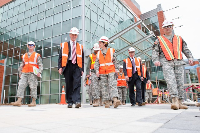 Secretary of the Army John McHugh (center left) walks out of the new Fort Belvoir Community Hospital Meadows Pavilion along with Col. Susan Annicelli (center right), commander of DeWitt Army Community Hospital, and other officials, April 13. The secretary visited the site of the new $1 billion hospital for a first-hand look at facilities which will provide care for wounded warriors.