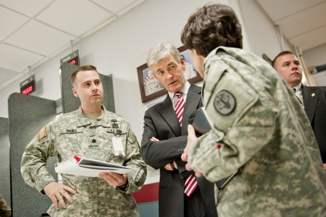 FORT BELVOIR, Va. -- Secretary of the Army John McHugh (center) listens as Col. Susan Annicelli, DeWitt Army Community Hospital commander, provides information on planned renovations during a tour here April 13, 2011. Looking on is Lt. Col. Chris Rheney (left), DeWitt's deputy commander for administration. The secretary visited DeWitt, as well as a new wounded warrior complex and the $1 billion Fort Belvoir Community Hospital for a firsthand look at facilities which will provide care for wounded warriors here. (U.S. Army photo by Marc Barnes)