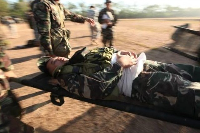 A simulated casualty is evacuated during a mass casualty training drill at Fort Magsaysay, April 13. The drill was a part of a live fire demonstration conducted during Balikatan 2011 for distinguished visitors