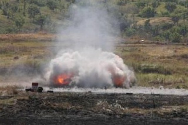 The explosion of an anti-personnel obstacle breaching system clears the way for a convoy during Balikatan 2011 at Fort Magsaysay, April 13. The anti-personnel obstacle clearing device was used in order to clear the path for humanitarian and disaster relief supplies during a live fire demonstration.