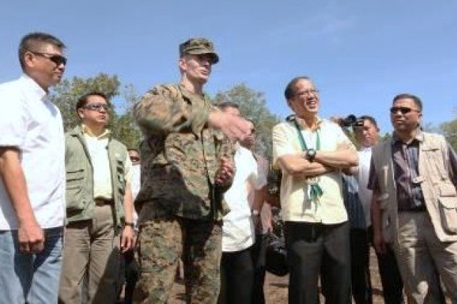 President Benigno S. Aquino III, president of the Philippines, talks with with Col. Stephen M. Neary, commander of Marine Forces and 4th Marine Regiment, 3rd Marine Division, III Marine Expeditionary Force, at a live fire demonstration on Fort Magsaysay, April 13. Aquino was one of many distinguished visitors who attended the demonstration.